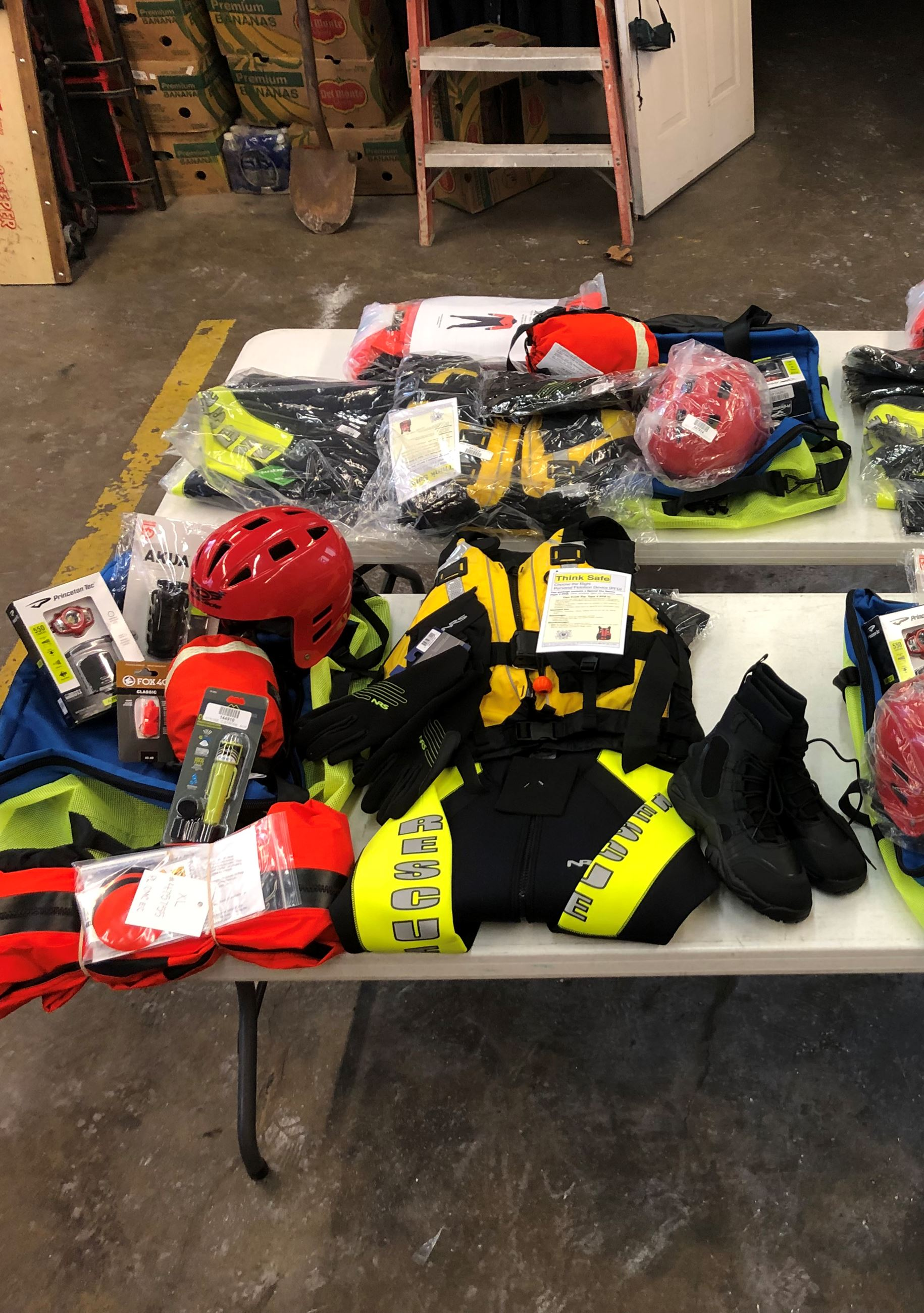 Swift-water rescue equipment spread out across a table