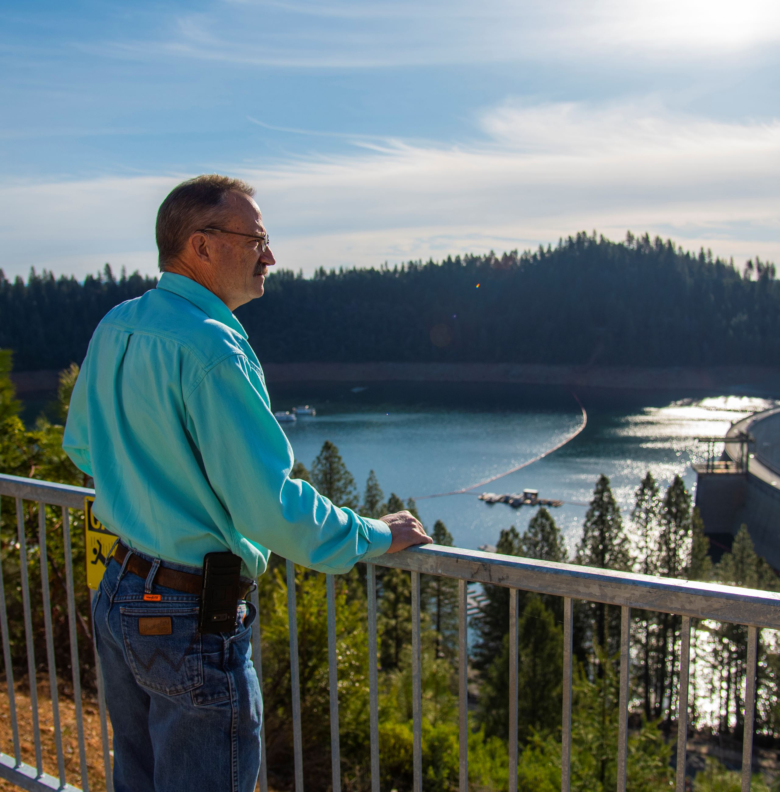 Yuba Water Agency employee Paul Breitag stands above New Bullards Bar Reservoir looking out over the