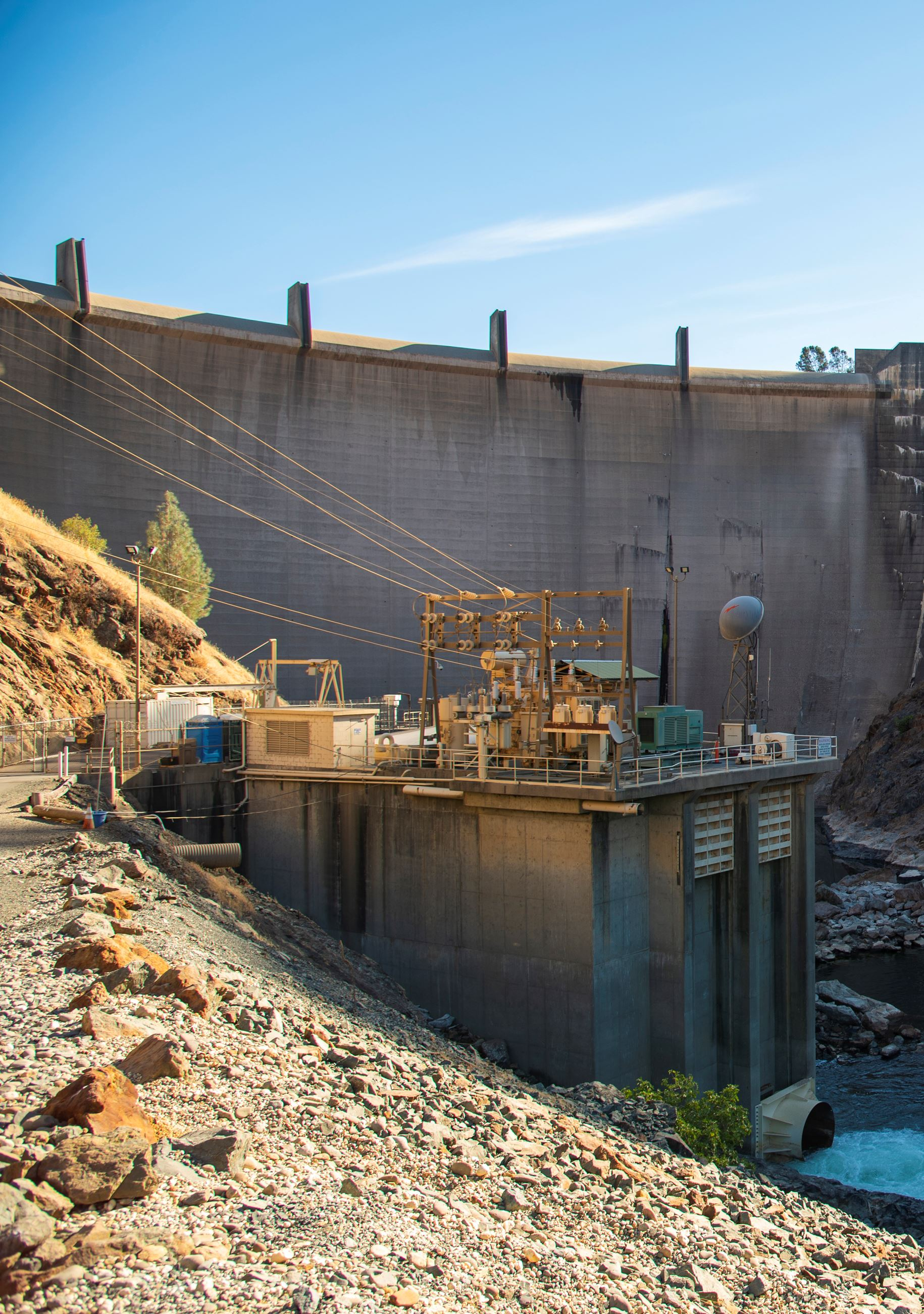 A photo of Yuba Water's Narrows 2 Powerhouse with Englebright Dam in the background.