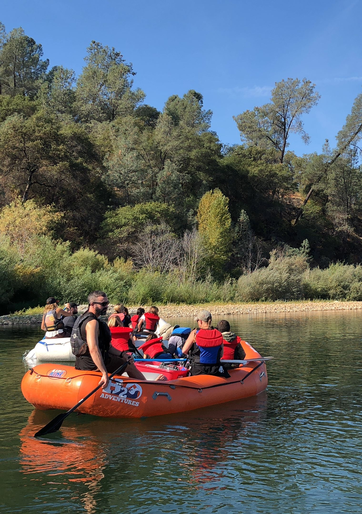 A photo of a group of kids on a raft floating down the Yuba River during a Salmon Expedition