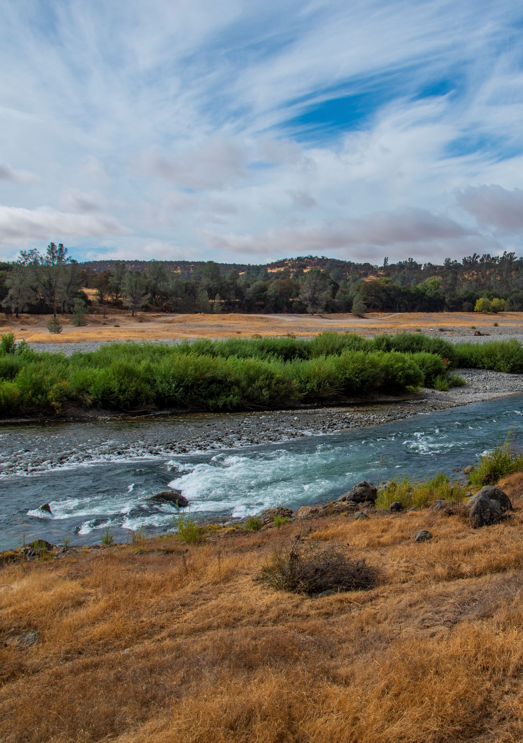 A photo of the lower Yuba River with lots of open space around.